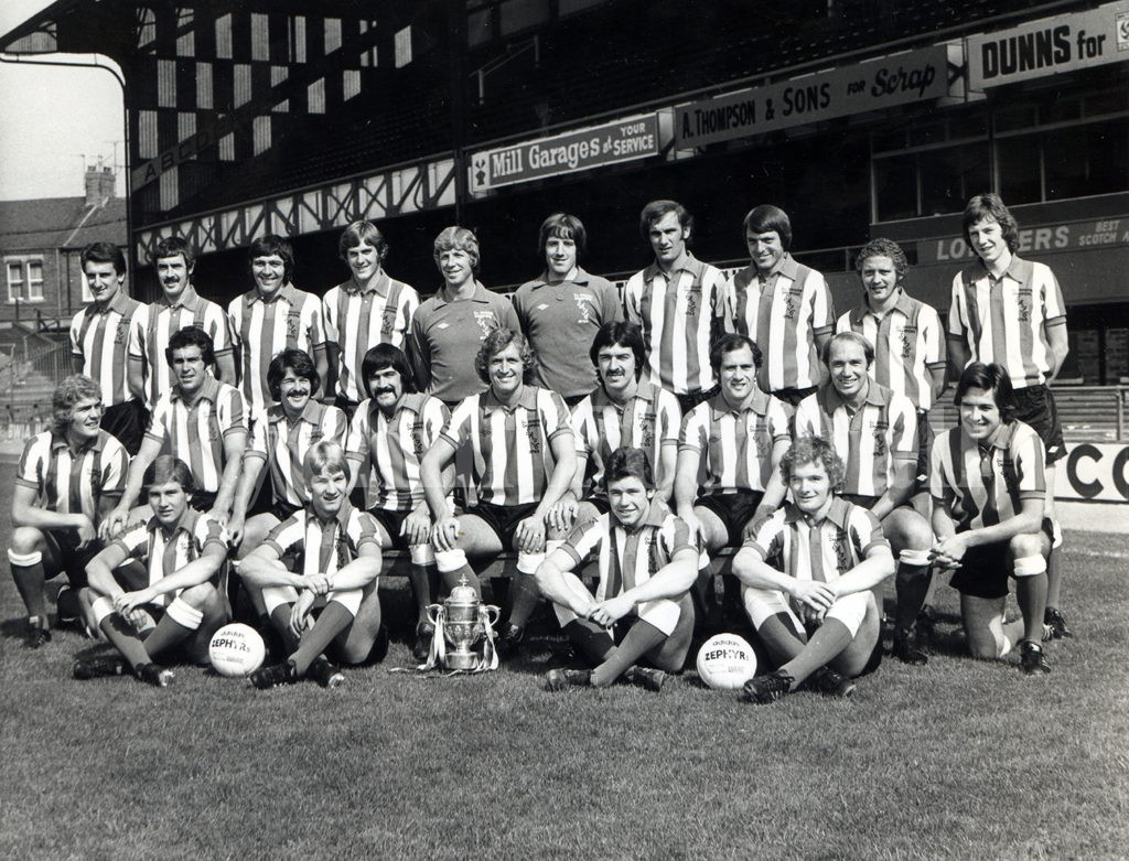 With the 1975–76 Second Division Championship trophy Back row – Bolton, Gibb, Porterfield, Ashurst, Montgomery, Swinburne, Malone, Longhorn, Train, Coady Middle row – Clarke, Moncur, Kerr, Hughes, Towers, Holden, Finney, Robson, Stronach Front row – Rowell, Elliott, Armstrong, Gilbert