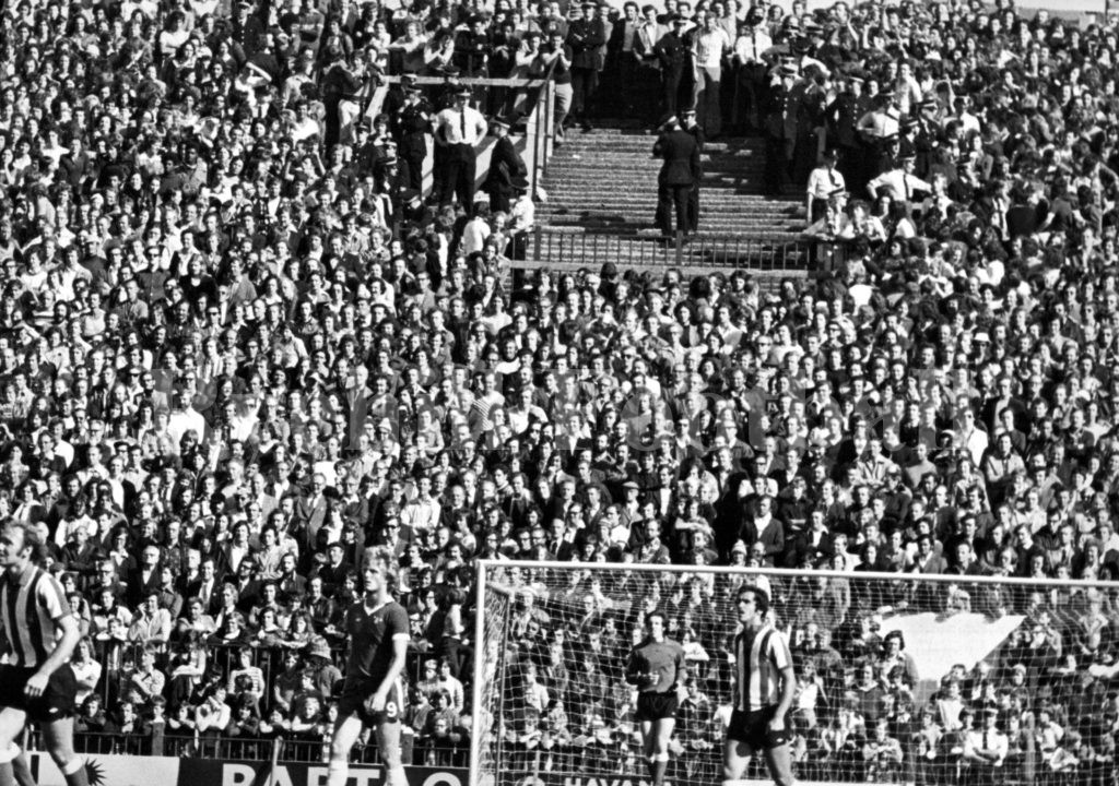 Police separate Sunderland and Chelsea fans in The Roker End; 16 August 1975