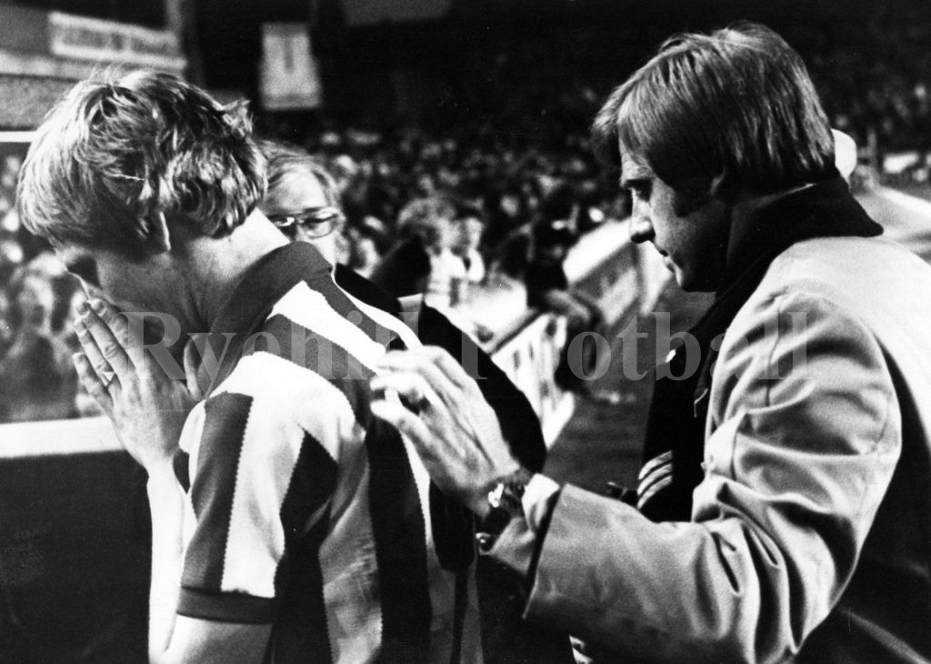 A distraught Shaun Elliott is consoled by Dave Merrington as they both leave the Goodison pitch following defeat at Everton and relegation.