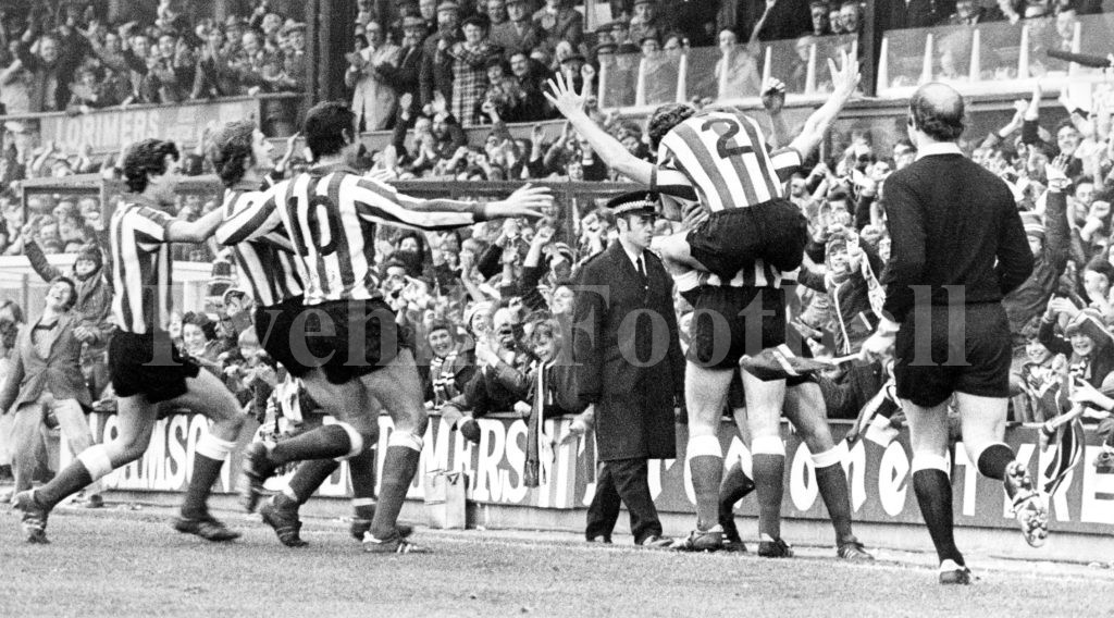 Colin Waldron is mobbed having scored the winner against Ipswich Town