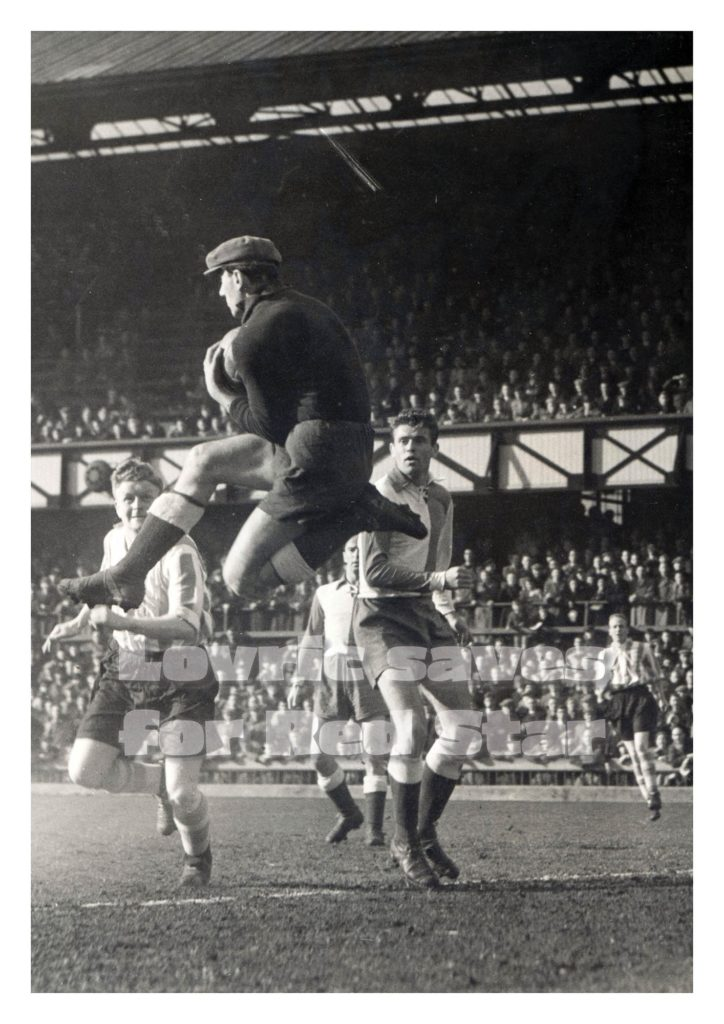 Red star keeper Lovric saves at the Roker End with Dickie Davis looking on.