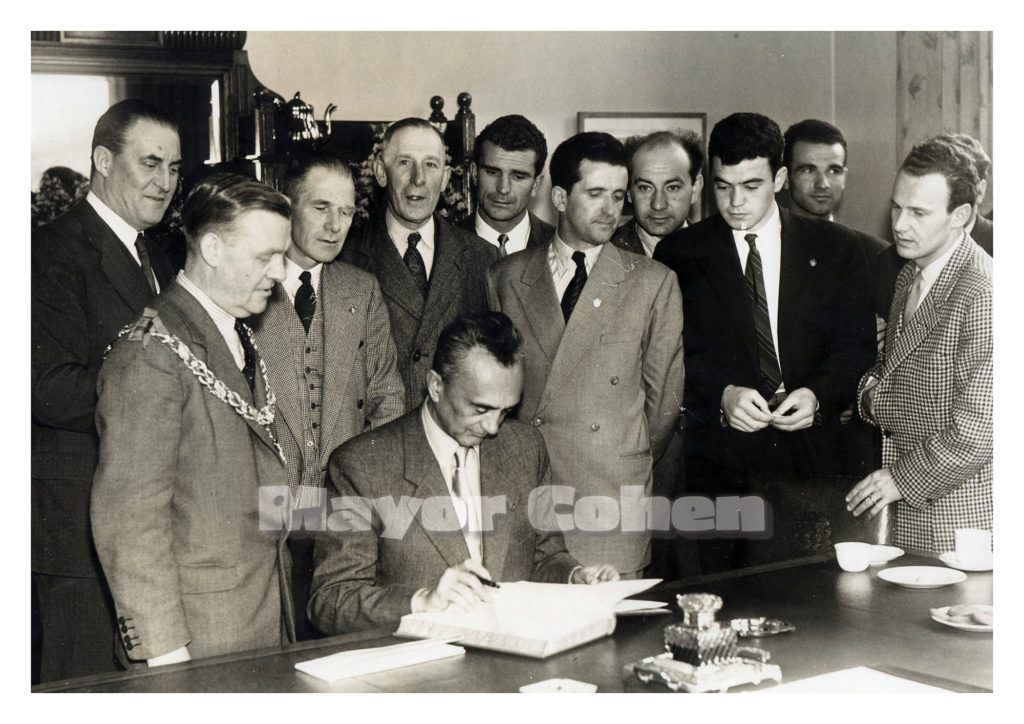 Sunderland's Mayor Cohen watches the Yugoslavian touring party sign a friendship agreement.